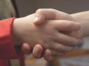 Kids shaking hands