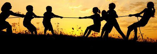 Children play tug of war
